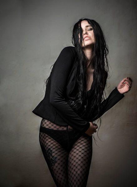 Foto Frau mit Netzstrumpfhose